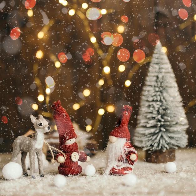 Cena de natal com luz de fundo Foto gratuita