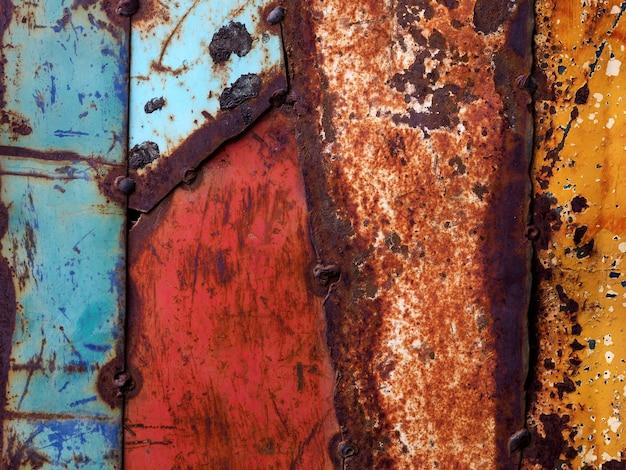 Chapas de aço pintadas velhas coloridas abstraem base Foto Premium