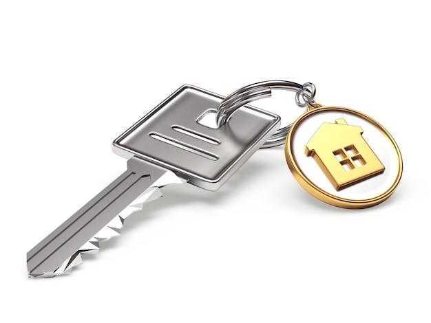 Chave de metal e chaveiro redondo com o ícone da casa Foto Premium