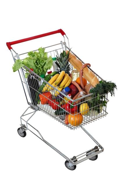 Cheio de carrinho de compras de alimentos isolado no branco. Foto Premium