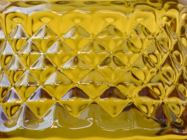 Cinge a superfície da forma do teste padrão do fundo dourado da garrafa de óleo. Foto Premium