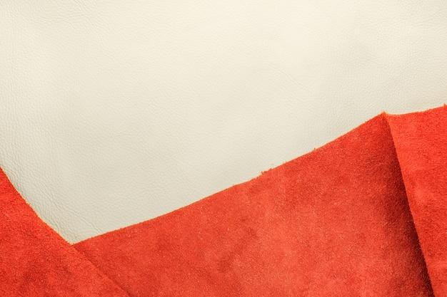 Close-up couro branco e couro camurça laranja dividir duas seções Foto Premium