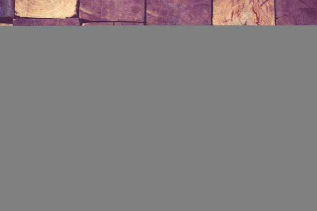 Close-up de fundo de textura de parede de bloco de madeira rústica, filtro vintage Foto Premium
