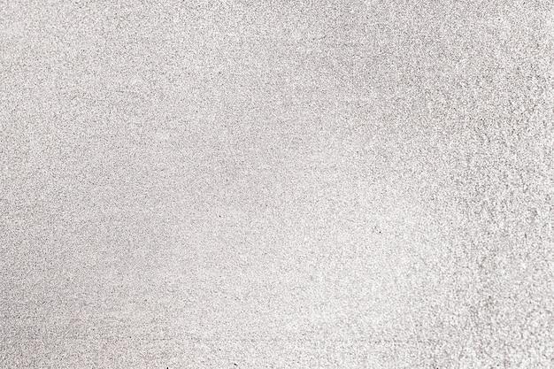 Close up de glitter cinza texturizado fundo Foto gratuita
