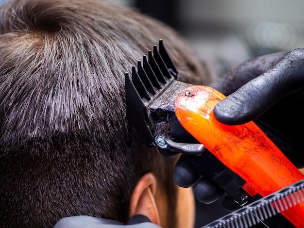 Close-up, de, laranja, aparador, corte cabelo Foto gratuita