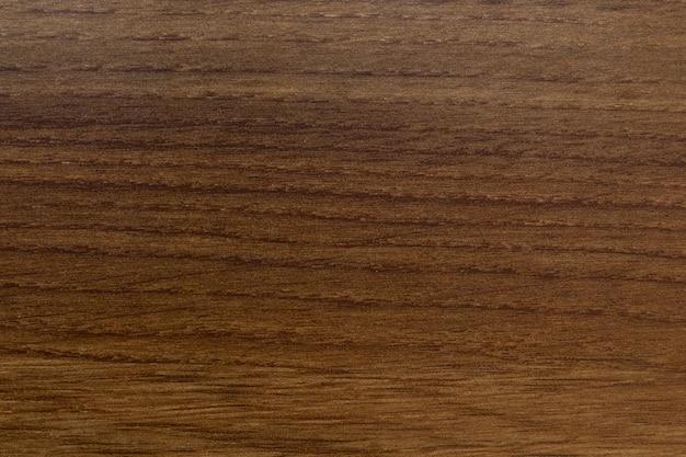 Close-up de textura de madeira âmbar com padrão natural em tons quentes para o fundo Foto Premium