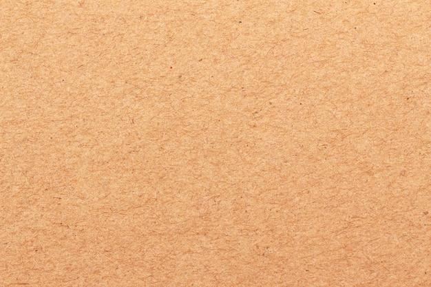 Close-up de textura de papel ofício marrom para plano de fundo Foto Premium