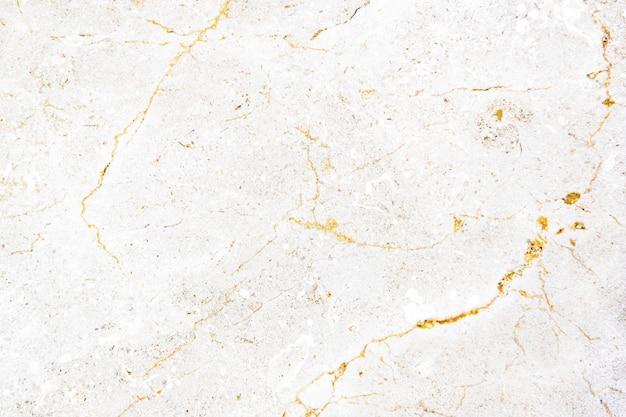 Close-up de uma parede texturizada de mármore branco Foto gratuita