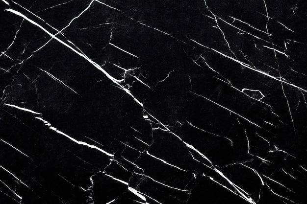 Close-up de uma parede texturizada de mármore preto e branco Foto gratuita
