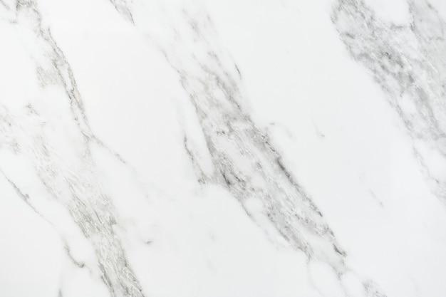 Close-up de uma parede texturizada de mármore Foto gratuita