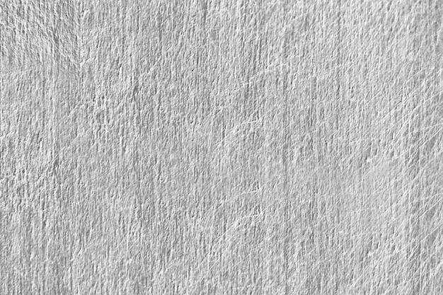 Close-up de uma textura de parede de concreto cinza riscado Foto gratuita