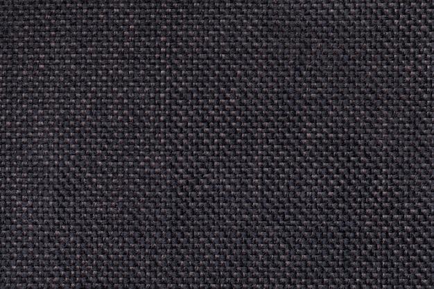 Close up do fundo de matéria têxtil do preto escuro. estrutura da macro de malha Foto Premium