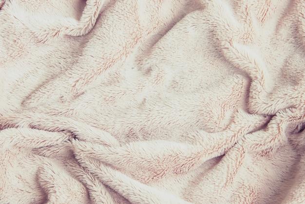 Close up feito malha morno geral da manta. foco seletivo. Foto Premium