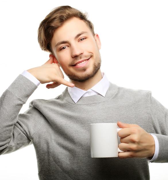 Close-up homem de negócios com uma xícara de café Foto Premium