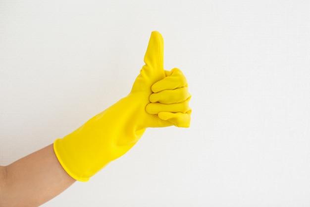 Close-up, mão, borracha, luva, mostrando, polegar, cima Foto gratuita