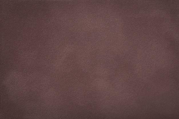 Close up matt da tela da camurça do marrom escuro. textura de veludo. Foto Premium