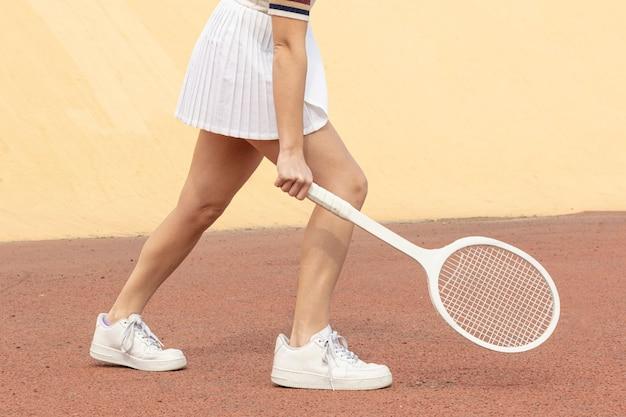 Close-up tenista bater posição de bola Foto gratuita