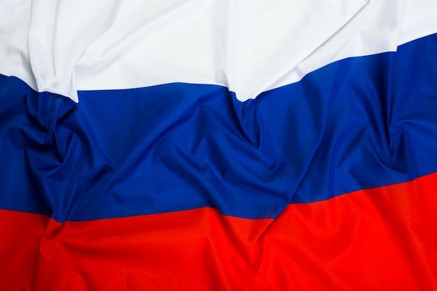 Close-up tiro da bandeira ondulada da rússia Foto Premium
