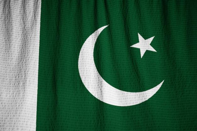 Closeup, de, babado, bandeira paquistão, bandeira paquistão, soprando, em, vento Foto Premium