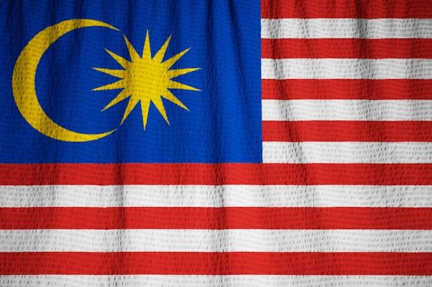 Closeup, de, babados, bandeira malásia, malásia, bandeira, soprando, em, vento Foto Premium
