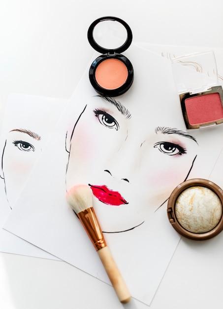 Closeup de blushers uma escova em um gráfico de rosto Foto Premium