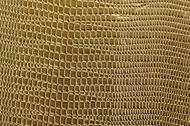 Closeup, de, dourado, scaly, textured, padrão, fundo Foto gratuita