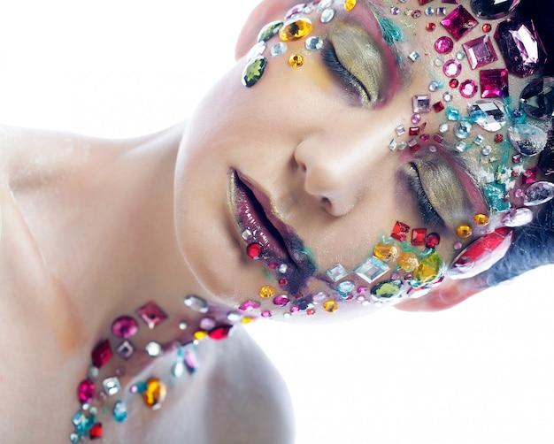 Closeup retrato de mulher com maquiagem artística. Foto Premium