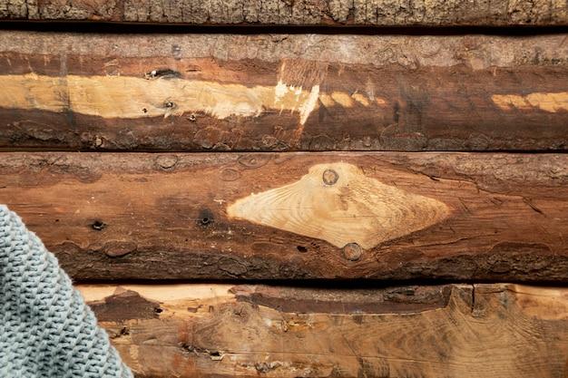Cobertor plana leigos na mesa de madeira Foto gratuita