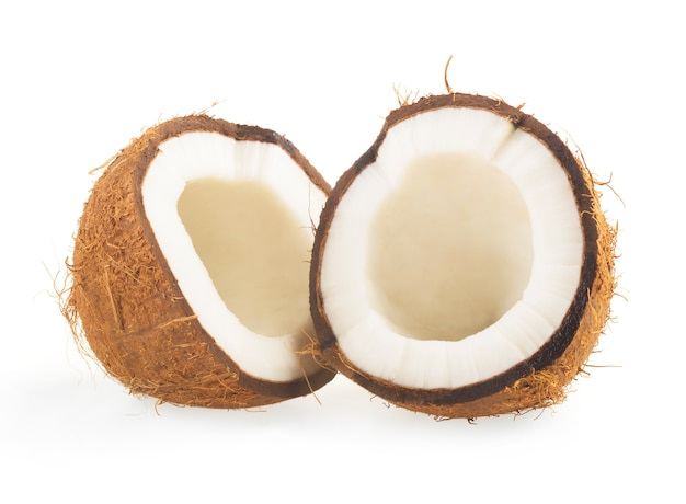 Coco cortado ao meio em branco Foto Premium