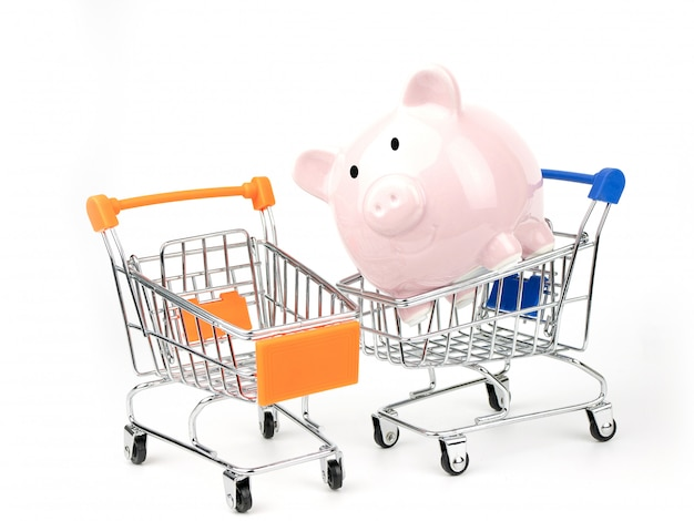 Cofrinho em um carrinho de compras Foto Premium
