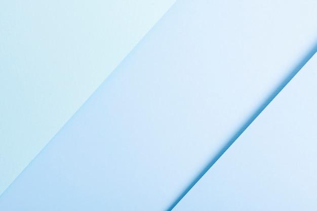 Coleção tonificada azul de folhas de papel alinhadas Foto gratuita