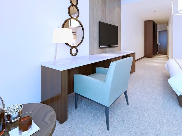 Cômoda moderna de estilo minimalista em quarto de hotel bem iluminado com espelho redondo combinado e abajur. Foto Premium