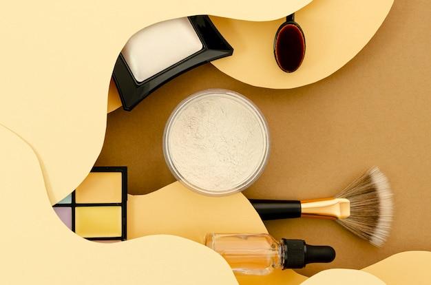 Composição de vista superior de cosméticos glamourosos Foto gratuita