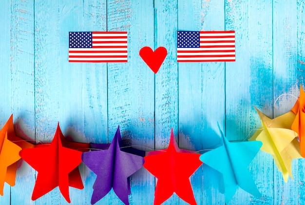 Composição do dia da independência com estrelas de papel Foto gratuita