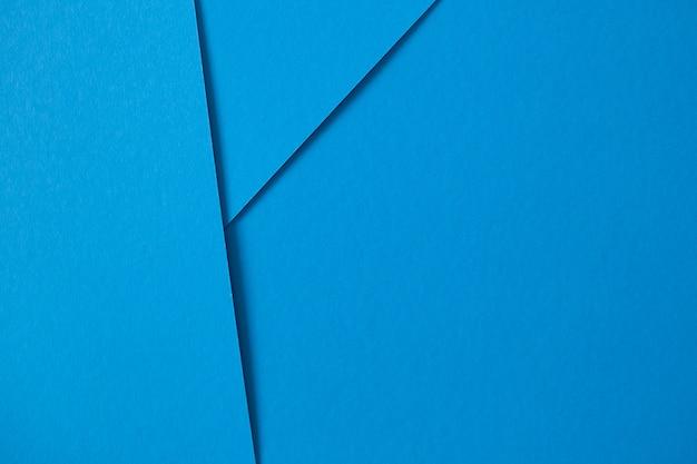 Composição geométrica com cartão azul com copyspace Foto gratuita
