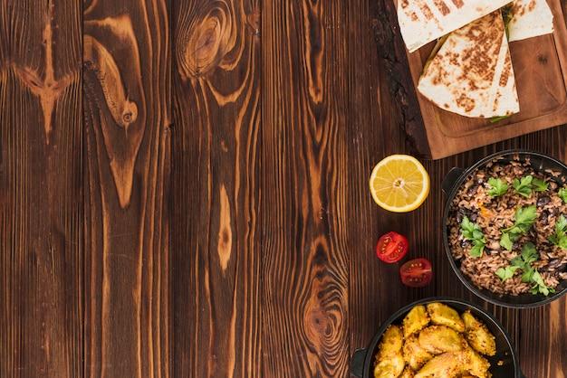 Composição plana leiga de comida mexicana com copyspace Foto gratuita