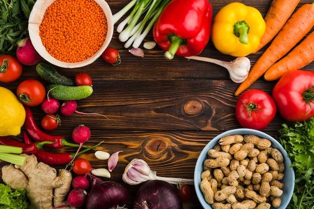 Composição plana leiga de legumes com copyspace Foto gratuita