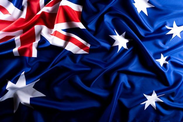 Conceito de dia da austrália. bandeira da austrália contra um fundo de quadro-negro Foto Premium