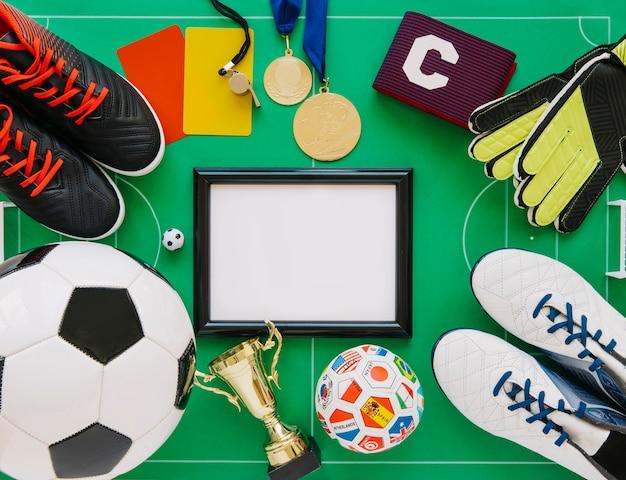 Conceito de futebol com moldura Foto gratuita