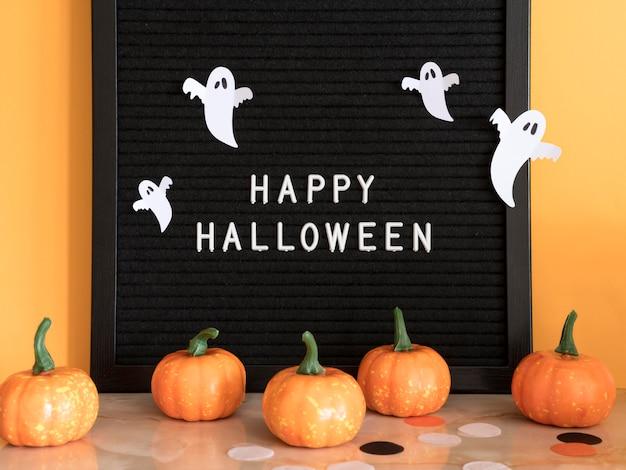 Conceito de halloween de frente com saudação Foto gratuita