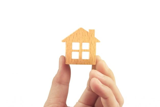 Conceito de hipoteca por casa na mão Foto Premium