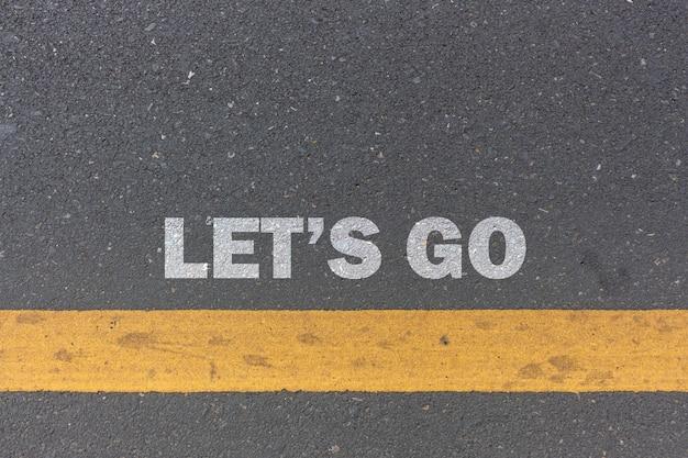 Conceito de negócios. vamos mensagem ou palavras impressas na estrada Foto Premium