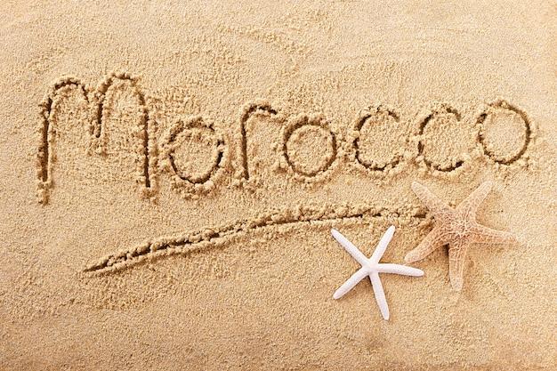 Conceito de viagens de mensagem de palavra de marrocos praia Foto Premium
