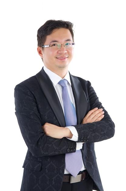 Confiante, sudeste asiático, homem negócios, cruzado, braços, sobre, fundo branco Foto Premium