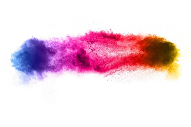Congelar o movimento de partículas de poeira colorida em branco Foto Premium