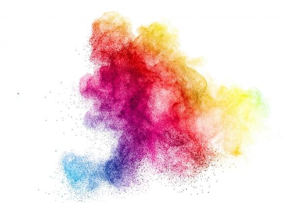 Congele o movimento de partículas de poeira coloridas na parede branca. textura abstrata da sobreposição do pó da cor pastel. Foto Premium
