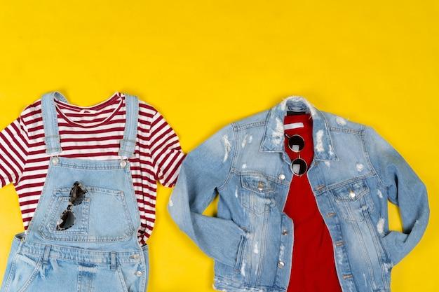 Conjunto de roupas femininas e acessórios em fundo amarelo brilhante Foto Premium