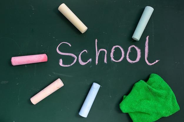 Conselho escolar com a inscrição escola Foto Premium