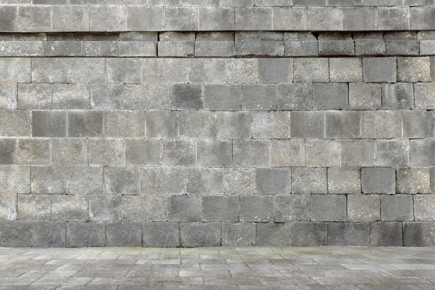 Construção de parede de pedra antiga Foto Premium