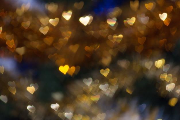 Coração forma bokeh luz de fundo, conceito de dia dos namorados amor casamento Foto Premium